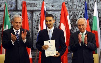 Better times ahead? Prime Minister Benjamin Netanyahu and President Shimon Peres thank a Turkish representative of the firefighting team that helped Israel douse the Carmel forest fire in December 2010 (photo credit: Abir Sultan/Flash90)