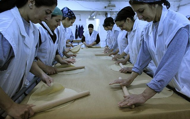 Women working in a matza factory (photo credit: Tsafrir Abayov/Flash90)