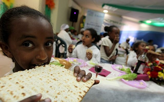 Jewish immigrants from Ethiopia attend a rehearsal Seder ahead of Passover, March 2012. (Kobi Gideon/Flash90)