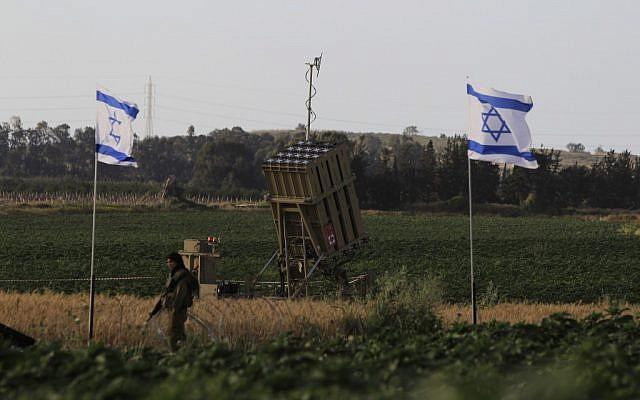 An Israeli soldier guards the Iron Dome missile defense system near the coastal city of Ashkelon (photo credit: Tsafrir Abayov/Flash90)