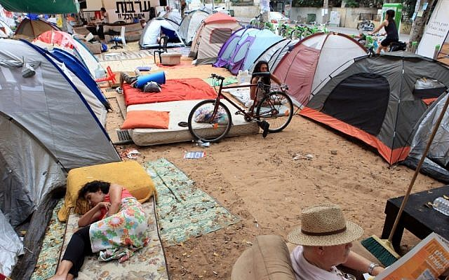 Fed up with the high cost of housing in Israel, thousands of Israelis set up tents on Rothschild Boulevard in Tel Aviv and elsewhere around the country last summer. (photo credit: Liron Almog/Flash90)