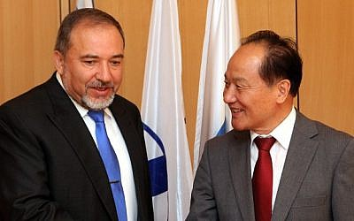 Chinese envoy to the Middle East Wy Sike meets with Israeli Foreign Minister Avigdor Lieberman in March (photo credit: Yossi Zamir/Flash 90)