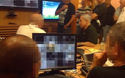Prime Minister Benjamin Netanyahu gets briefed at the Foreign Ministry situation room during the rescue of Israeli security personnel from the stormed embassy in Cairo last September. (photo credit: GPO/Flash90)