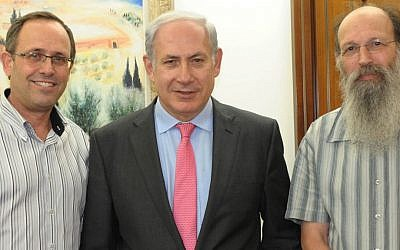 Prime Minister Benjamin Netanyahu (center) with Bar-Ilan University CEO Chaim Glick (left) and Professor Michael Weingarten, vice dean of the Faculty of Medicine, at the opening of Bar-Ilan University's Medical School last September (photo credit: Moshe Milner/GPO/Flash90)