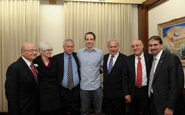 Ilan Grapel (center), released from incarceration in Egypt in 2011, with Prime Minister Benjamin Netanyahu and others. (photo credit: Amos Ben Gershom/GPO/Flash90)