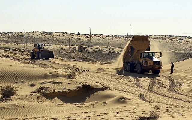 Construction on the new barrier along the Israeli-Egyptian border in March (photo credit: Tsafrir Abayov/Flash90)