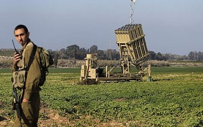 A soldier standing near an Iron Dome battery, part of Israel's missile defense system (photo credit: Tsafrir Abayov/Flash90)