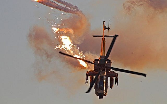 An Israeli Apache helicopter fires missiles during a training exercise (Illustrative photo:Ofer Zidon/Flash90)