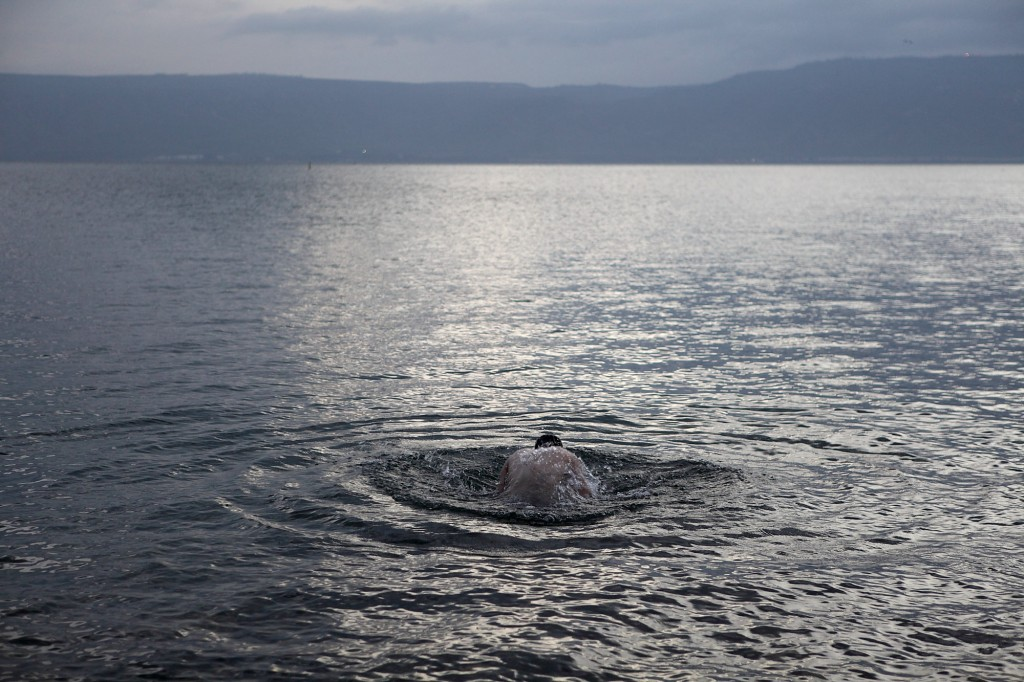 Sea of galilee rises 30 centimeters in five days the times of israel a man takes a swim in the sea of galilee photo credit yaakov nahumi publicscrutiny Images