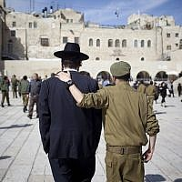 Soldier and ultra-Orthodox man, shoulder to shoulder (Yonatan Sindel/Flash90)