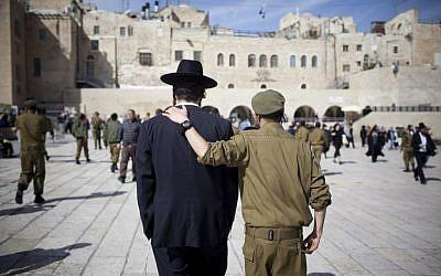 Soldier and ultra-Orthodox man, shoulder to shoulder (Yonatan Sindel/Flash90)