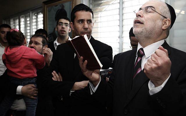 Former minister Shlomo Benizri prays at his house in Jerusalem after his release. (photo credit: Kobi Gideon/Flash90)