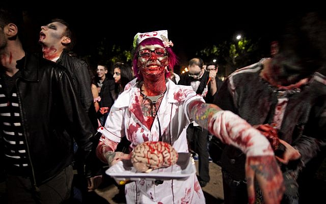 Israeli youth take part in an annual Zombie Walk procession ahead of the Jewish holiday of Purim, in Tel Aviv. March 06, 2012. (photo credit: Dima Vazinovich/Flash90)