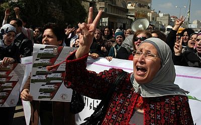 Palestinian women show their solidarity with female Palestinian hunger striker Hana Shalabi, at the Qalandia checkpoint near the West Bank city of Ramallah on March 08, 2012. (photo credit: Issam Rimawi/Flash90)
