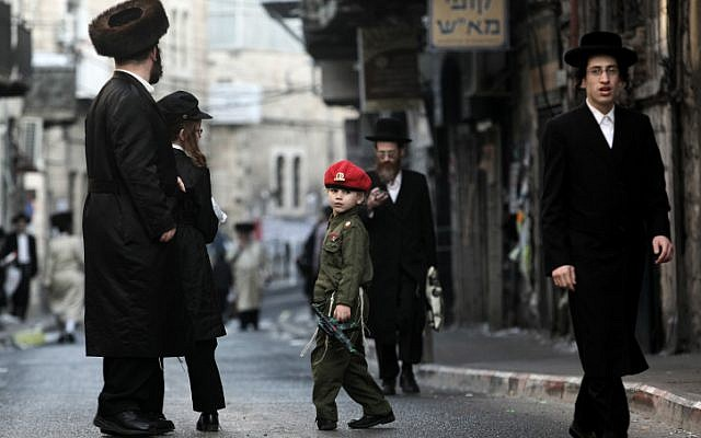Israeli public opinion wants this ultra-Orthodox child dressed up for Purim to wear a similar uniform when he turns 18. (photo credit: Kobi Gideon/Flash90)