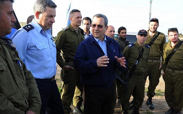 Defence Minister Ehud Barak visits the Iron Dome anti-rocket defence system in Southern Israel on Saturday, March 10. The missile defense system intercepted more than two dozen rockets launched from Gaza at Israel's southern cities in the previous 24 hours. (photo credit: Ministry of Defence/Flash90)