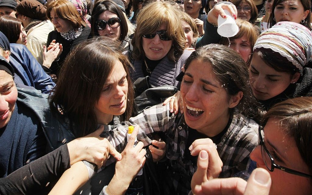 The sister of 8-year-old Miriam Monsonego cries at the Jerusalem funeral of Miriam and the three other Toulouse Jewish school shooting victims, March 2012. (photo credit: Miriam Alster/Flash90)