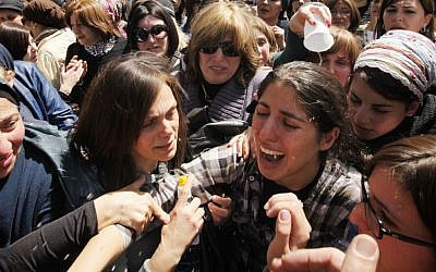 The sister of 8-year-old Miriam Monsonego cries at the Jerusalem funeral of Miriam and the three other Toulouse Jewish school shooting victims. (photo credit: Miriam Alster/Flash90)