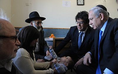 Prime Minister Benjamin Netanyahu visits Eva Sandler, wife of Rabbi Jonathan Sandler and mother of  Arieh and Gabriel, the victims of Monday's shooting in Toulouse. (photo credit: Amos Ben Gershom/GPO/FLASH90)