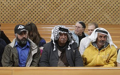 .Abed al-Kader Muhammad Moatan (center) and two other Palestinian petitioners to the High Court of Justice on Thursday (Photo credit: Uri Lenz/ Flash 90)