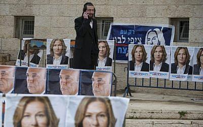 An ultra-Orthodox man walks among Kadima party election posters in Jerusalem, March 27, 2012 (photo credit: Yonatan Sindel/Flash90)