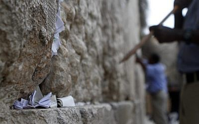 After removal, the thousands of notes are buried on the nearby Mount of Olives. (photo credit: Uri Lenz/Flash90)