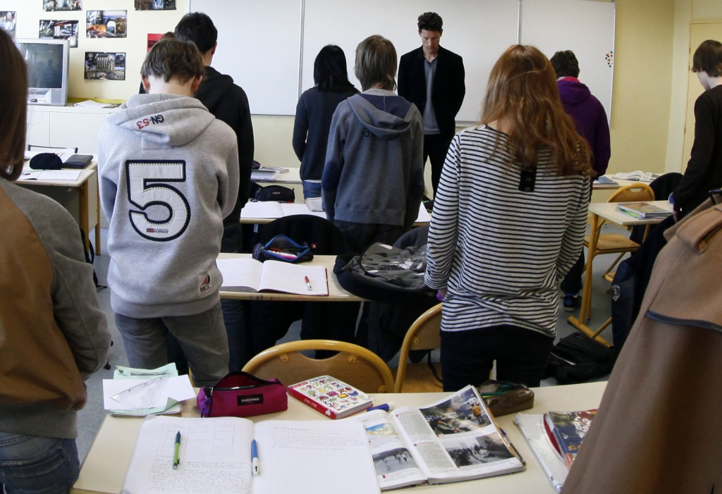 French students in a moment of silence the day after gunman Mohamed Merah murdered three children and a teacher at the Ozar Hatorah school in Toulouse (photo credit: Michel Spingler/AP)