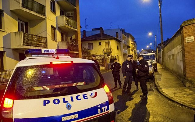 French police secure the area where they exchanged fire and were negotiating with a gunman who claims connections to al-Qaeda. (photo credit: AP Photo/Bruno Martin)