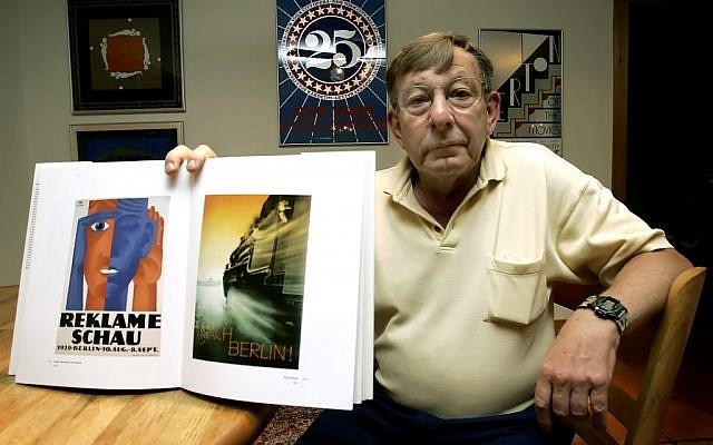 Peter Sachs holds up a book with some of his father, Hans Sachs', favorite posters. (photo credit: AP/Chris O'Meara)