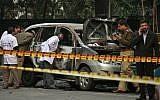 Indian police forensics experts investigating the scene after an explosion tore through a car belonging to the Israel Embassy in New Delhi, India (photo credit: AP/Kevin Frayer/File)