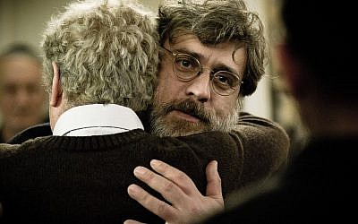 Lior Ashkenazi hugs Shlomo Bar Aba in a scene from 'Footnote.' (Photo credit: Sony Classics)