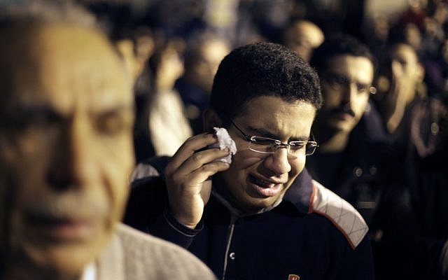An Egyptian Christian weeps during prayers in Cairo. (photo credit: AP/Amr Nabil)