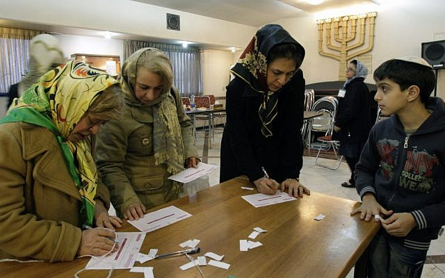 Iranian Jewish women fill in their ballots during the parliamentary elections, in Iran, March 3, 2012, (photo credit: AP Photo/Vahid Salemi)