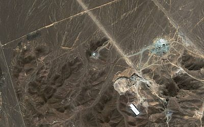 A file satellite image taken Sunday Sept. 27, 2009, provided by DigitalGlobe, shows a suspected nuclear enrichment facility under construction inside a mountain located north of Qom. (photo credit: AP)
