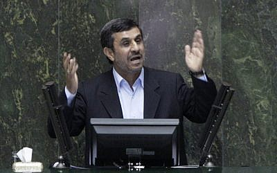 Iranian President Mahmoud Ahmadinejad answers questions in an open session in parliament in Tehran on Wednesday. (photo credit: AP/Vahid Salemi)