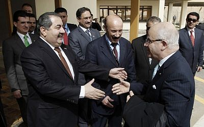 Iraqi foreign minister Hoshyar Zebari greets his Algerian counterpart in Baghdad (photo credit: AP/Mohammed Ameen)