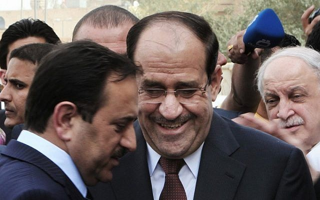 Iraqi Prime Minister Nuri al-Maliki, center (photo credit: AP/Ali Haider)