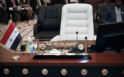 Syria's empty seat at the Baghdad summit (photo credit: AP/Karim Kadim)