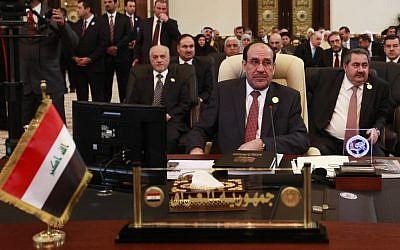 Iraqi prime minister Nuri Al-Maliki at the Baghdad Summit on Thursday (photo credit: AP/Karim Kadim)