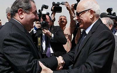 Iraqi Foreign Minister Hoshyar Zebari (left) shakes hands with Arab League Secretary General Nabil Al-Araby (photo credit: AP/Hadi Mizban)