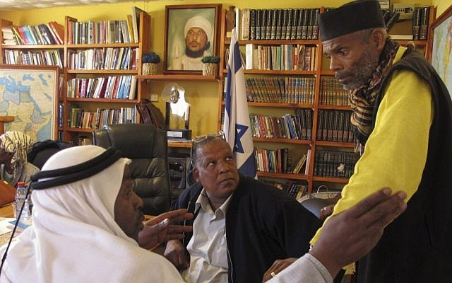 Sheik Ayed al-Abed and Mohammed al-Masri and Khazrail Ben-Yehuda talk in a meeting room in the southern Israeli city of Dimona. (photo credit: AP)