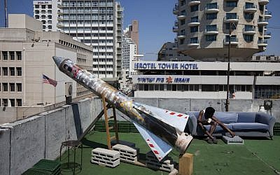 A model of a rocket is displayed on a roof next to the US embassy as part of an art exhibition called 'Iran' at a gallery in Tel Aviv. (photo credit: AP/Oded Balilty)