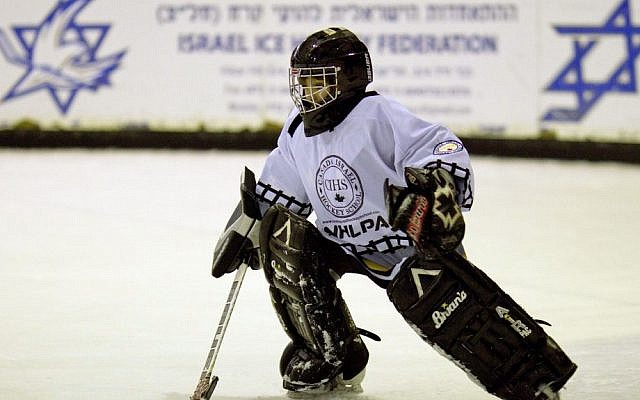 A member of the Canadian-sponsored Arab-Jewish ice hockey team during practice in Metulla, Israel. (photo credit: AP Photo/Ariel Schalit)