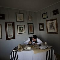 Calligraphy expert Avraham Borshevsky practices at his studio in Jerusalem. (photo credit: AP/Bernat Armangue)
