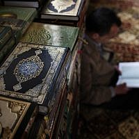 A Palestinian muslim worshipper reads the Holy book of Quran inside a Mosque in the West Bank city of Ramallah. (photo credit: AP/Bernat Armangue)