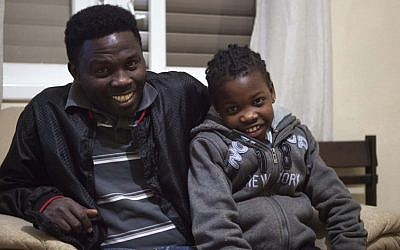 Cassiase Mahroum and his daughter Venus are among those who need to leave Israel (photo credit: Dan Balilty/AP)