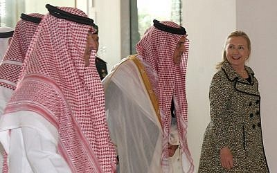 US Secretary of State Hillary Rodham Clinton, right, walks with Saudi Foreign Minister Prince Saud Al Faisal, center, after her meeting with King Abdullah of Saudi Arabia (photo credit: AP Photo)