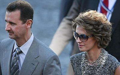 Syrian President Bashar Assad and his wife, Asma (photo credit: AP/Michel Spingler/File)