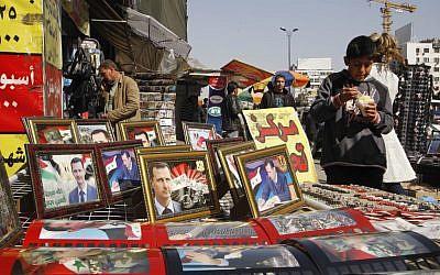 Pictures of Bashar Assad on sale in Damascus, March 22 (photo credit: AP/Muzaffar Salman)