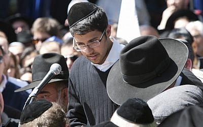 Avishai Monsonego, brother of Miriam Monsonego, at Miriam's funeral in Jerusalem Wednesday. Miriam was killed in a shooting attack at her school Monday. (photo credit: Yonatan Sindel/Flash90)